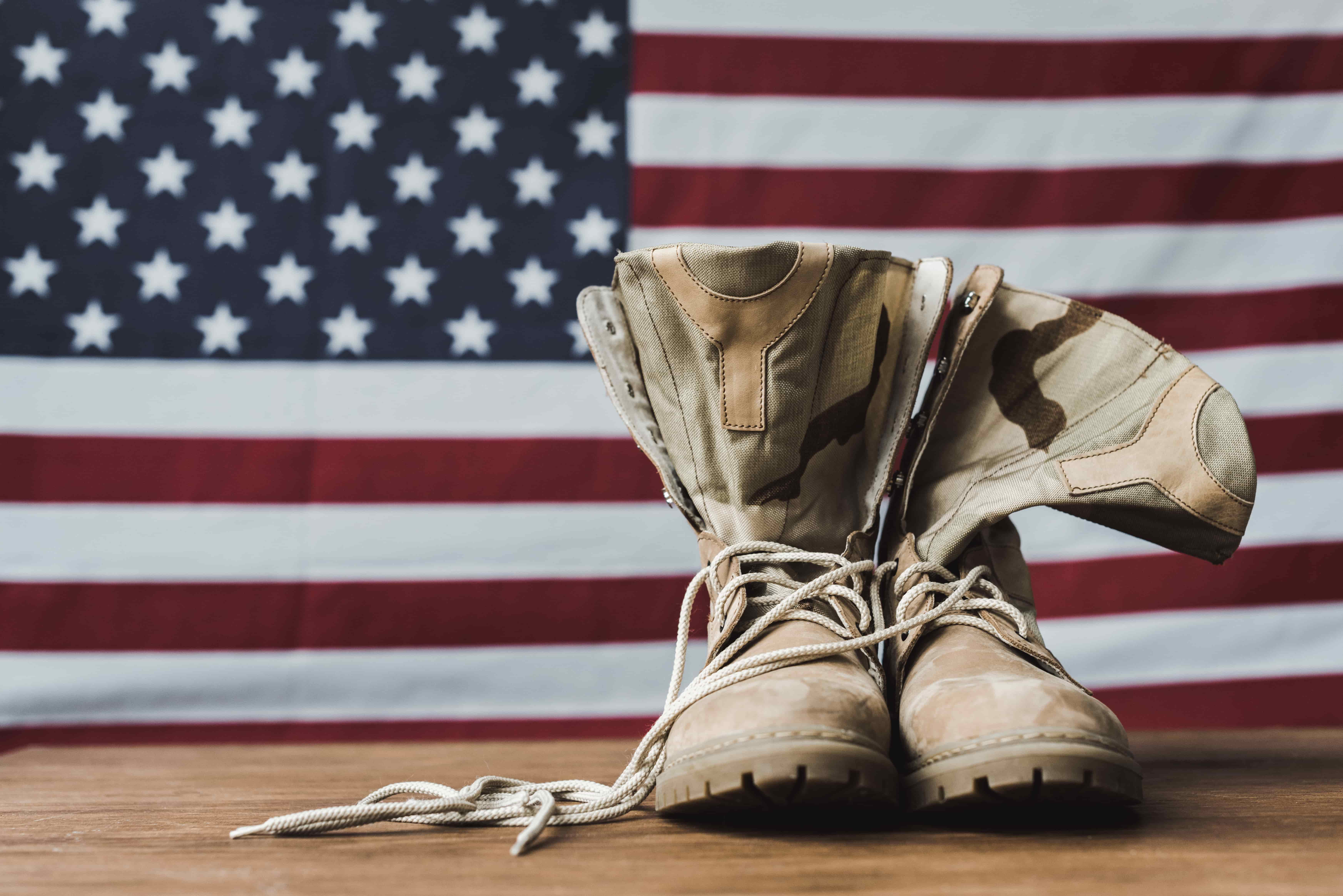 picture of military boots with american flag in background